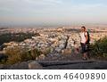 woman sitting on Lycabettus Hill 46409890
