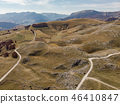 Rural road in unspoiled hills and steppe in Bosnia 46410847