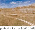 Dirt road in remote Bosnia steppe 46410848