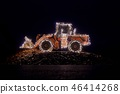 Blurred wheel loader decorated with christmas lights 46414268