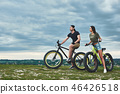 Afternoon sunset with mountainbike couple. Side view 46426518