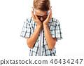 Teen boy than the upset wipes his hand tears 46434247