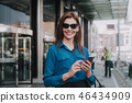 Portrait of stylish beautiful woman stay on street 46434909