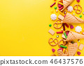 Funny tasty sweets on yellow background 46437576
