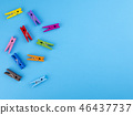 Colorful wood clothespins pegs on blue background 46437737