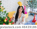 Happy woman holding a gifts boxed in Christmas 46439186