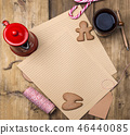 A letter for Santa Claus at Christmas. Wooden background, tea, ginger cookies and list. Free space 46440085