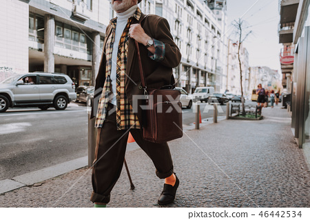 Hipster old man passing along the street 46442534