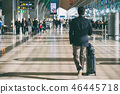 Businessman carrying suitcase in airport. 46445718