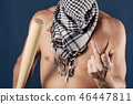 Portrait of a shirtless man in checkered scarf 46447811
