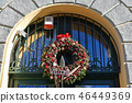 Christmas wreath on the wall of a building 46449369
