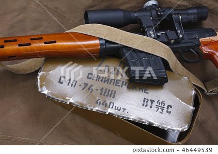 SVD sniper rifle with box of ammunition on canvas  46449539