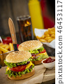 Burger with French fries cutlet with cheese and tomato 46453117