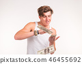 Rich, fun and finance concept - handsome young man throws money over white background. 46455692