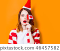 woman in Santa Claus hat with Canada flag 46457582
