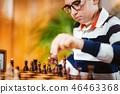 School boy playing chess 46463368