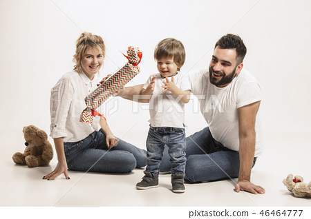 happy family with kid sitting together and smiling at camera isolated on white 46464777
