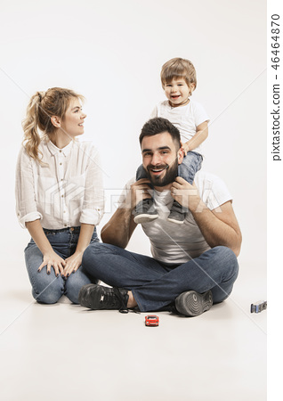 happy family with kid sitting together and smiling at camera isolated on white 46464870
