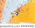 girl climbing up the wall 46464981
