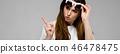 Portrait of emotional beautiful plus size model in sunglasses standing in studio looking in camera 46478475