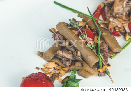Delicious meal with baked vegetables and sauce 46480388