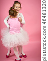 two cute little girls in tulle skirts on a pink background 46481320