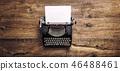 Vintage typewriter paper wooden background toned 46488461