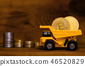 Yellow toy dumper loaded with golden bitcoins 46520829