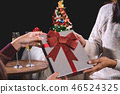 Beautiful two women holding gift boxes and two glasses with cham 46524325