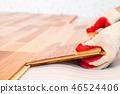 Installation of wooden floorboard 46524406