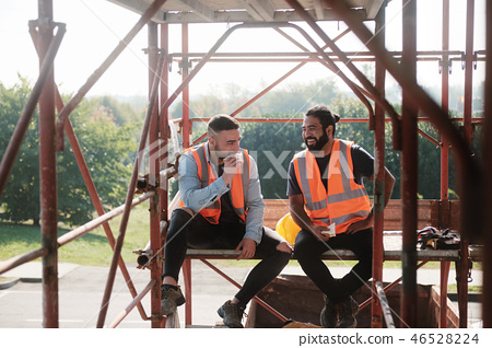 Happy Workers In Construction Site During Lunch Break 46528224