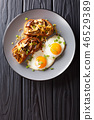 breakfast of shiitake toasts and fried eggs 46529389