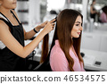 Calm lady smiling while visiting her hairdresser 46534575