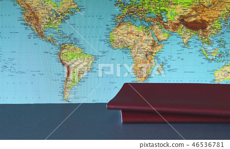 Two passports lie on the background of the world map, the concept of travel and the choice of route 46536781