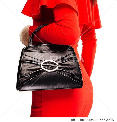 Beautiful woman with a black handbag in her hands 46540915