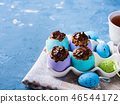 Easter background with cakes in eggs 46544172