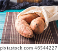 Sweet potato tubers in a reusable cotton bag 46544227