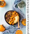 Turmeric Yogurt bowl with persimmon and granola 46544263