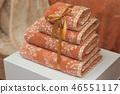 closeup of orange bath towels pile on in store 46551117