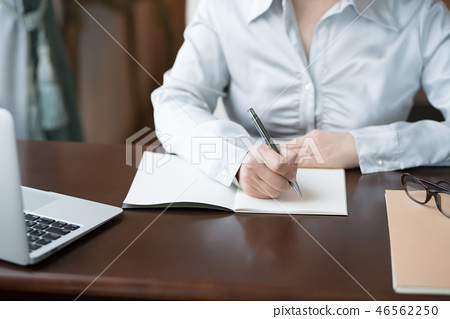 Woman writing a letter (out focus) 46562250