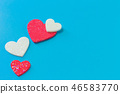 The  heart on blue background close up image. 46583770