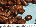 Dark many roasted coffee beans on blue background 46593115
