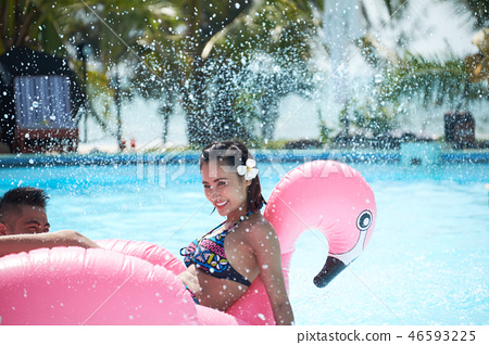 Young couple swimming outdoors 46593225