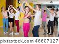 Tweens practicing jive in dance class 46607127