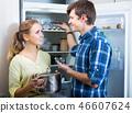 Happy family standing near refrigerator 46607624