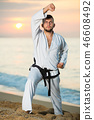 Nice male doing karate at ocean quay 46608492