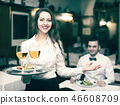 Waitress with beverages 46608709