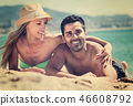Young couple at sea shore 46608792