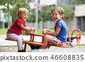Children having fun at playground 46608835