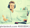 Portrait of young businessman with headset 46608841